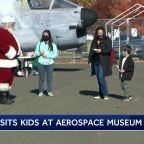 Santa Claus visits kids at Aerospace Museum of California
