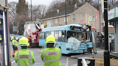 Bus 'with 25 kids on board' crashes into shop