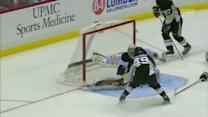 Chris Kunitz backhands one past Ryan Miller