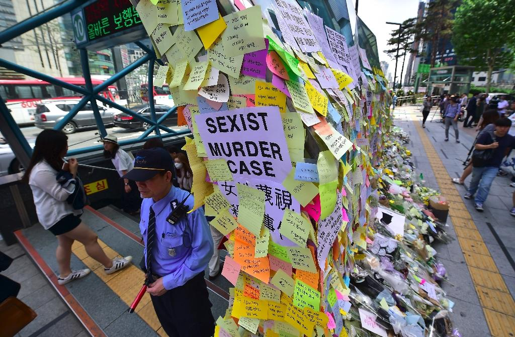 An exit of Seoul's Gangnam station is turned into a shrine for a 23-year-old woman who was stabbed to death by a stranger in a nearby public bathroom (AFP Photo/Jung Yeon-Je)