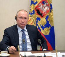 Putin takes coronavirus precautions as Moscow unveils tracking app