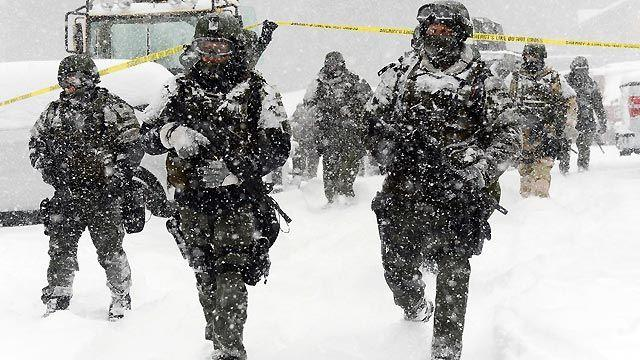 Snow helping, hurting manhunt for cop-killer