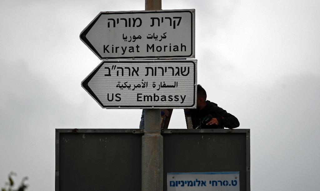 A road sign indicating the way to the new US embassy in Jerusalem is set up on May 7, 2018