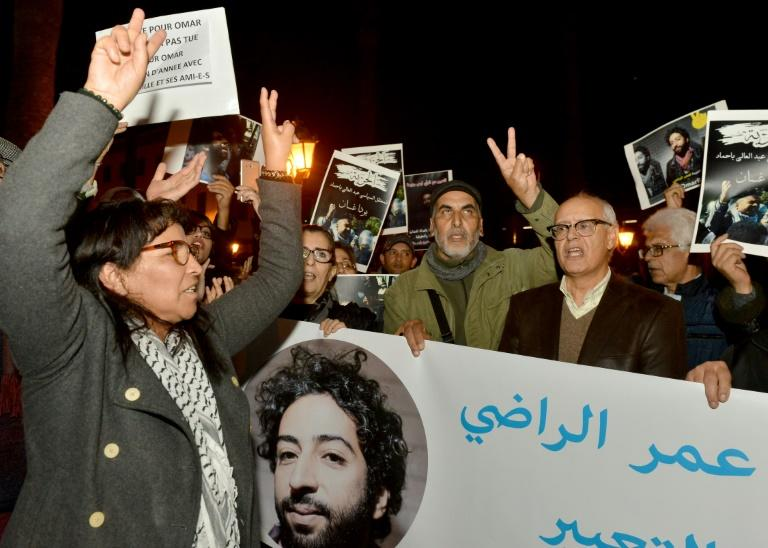 Demonstrators shout slogans in support of Omar Radi (pictured on the banner), a Moroccan journalist detained over tweet criticising judge, during a demonstration, on December 28, 2019, in the city of Rabat