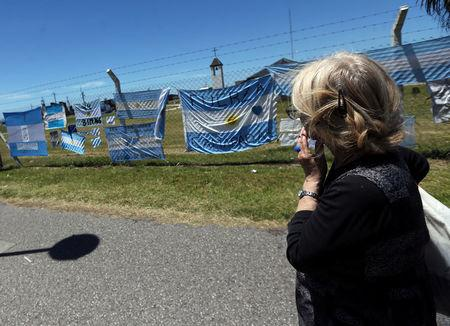 A woman looks at banners in support of the 44 crew members of the missing at sea ARA San Juan submarine, outside an Argentine naval base in Mar del Plata, Argentina November 25, 2017. REUTERS/Marcos Brindicci