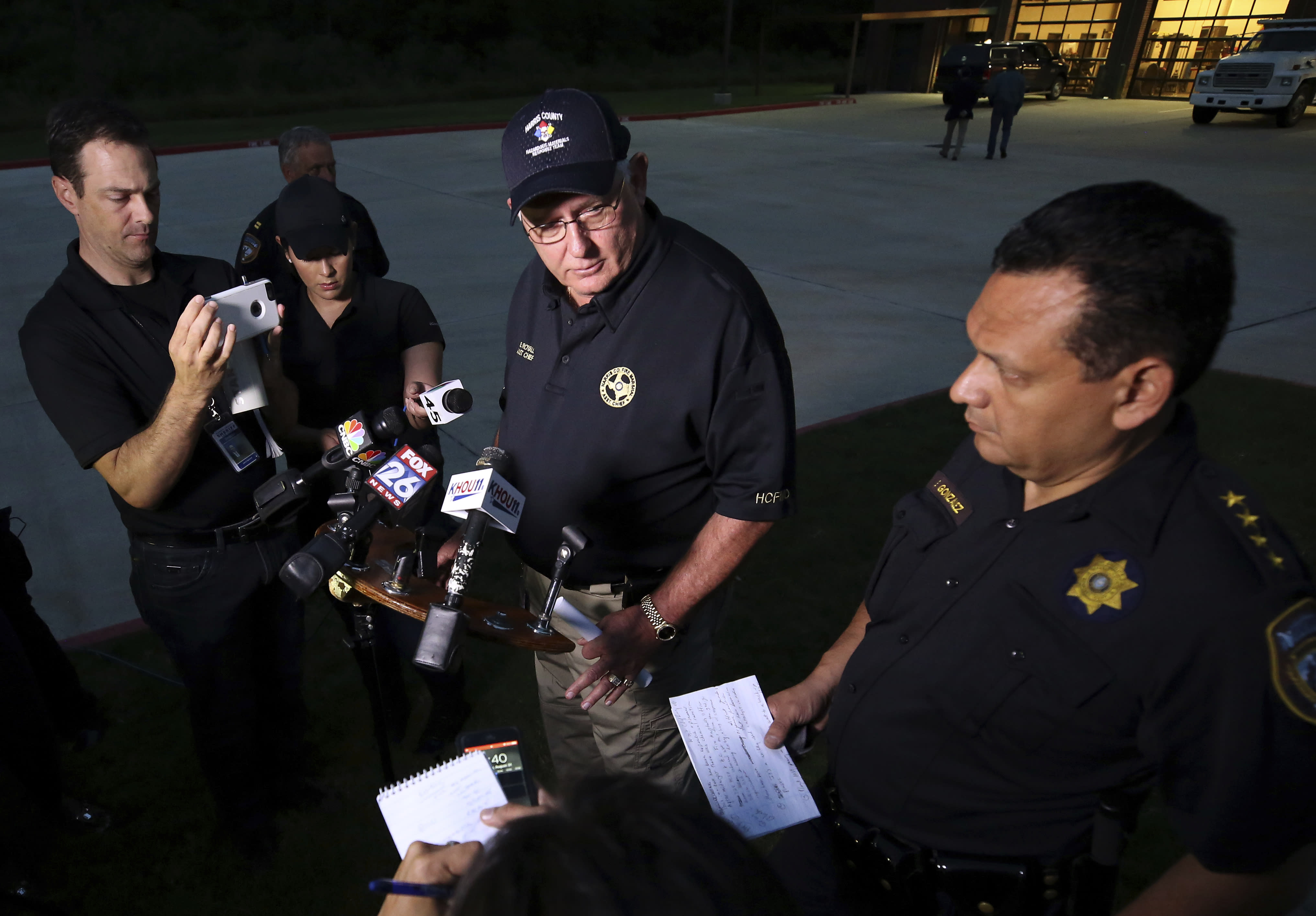 <p>Harris County Fire Marshal Assistant Chief Bob Royall, center, and Harris County Sheriff Ed Gonzalez speak about the explosion of organic peroxides at the Arkema chemical plant during a press conference outside the Crosby Fire Department Thursday, Aug. 31, 2017, in Crosby, Texas. Fifteen Harris County Sheriff Office deputies that first responded to the fire at the plant were sent to the hospital. (Photo: Godofredo A. Vasquez/Houston Chronicle via AP) </p>