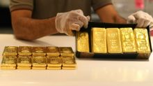 Stocks falter as safe haven gold climbs above $1,800