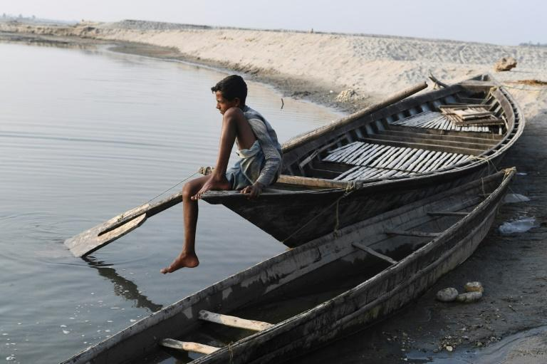A boy sits on a boat in Barpeta village in Assam, where many residents were left off a newly compiled register of citizens (AFP Photo/SAJJAD HUSSAIN)