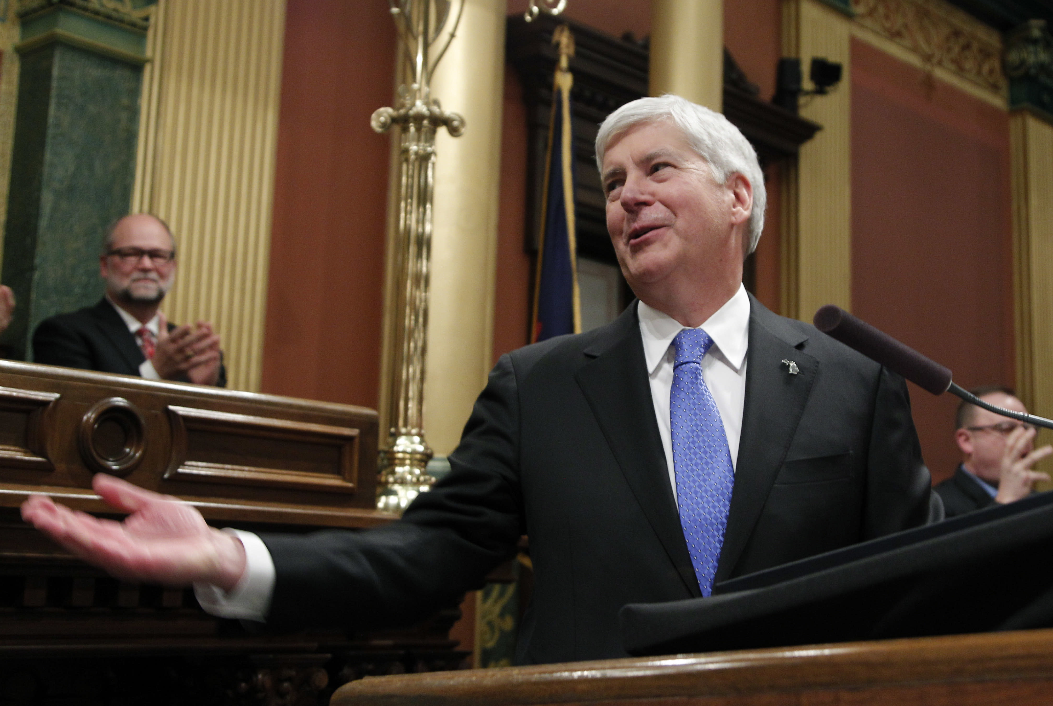 Michigan Gov. Rick Snyder addresses a joint session of the House and Senate at the state Capitol in Lansing, Mich. Braced for a new era of divided government, lame-duck Republicans who have long controlled two upper Midwest states are priming last-ditch laws to advance their conservative agenda or to weaken the influence of Democratic governors-elect. The moves, which may spark lawsuits if they come to pass, would follow midterm elections in which Democrats swept statewide offices in Michigan and Wisconsin for the first time in decades but fell short of taking over gerrymandered legislatures. (AP Photo/Al Goldis)