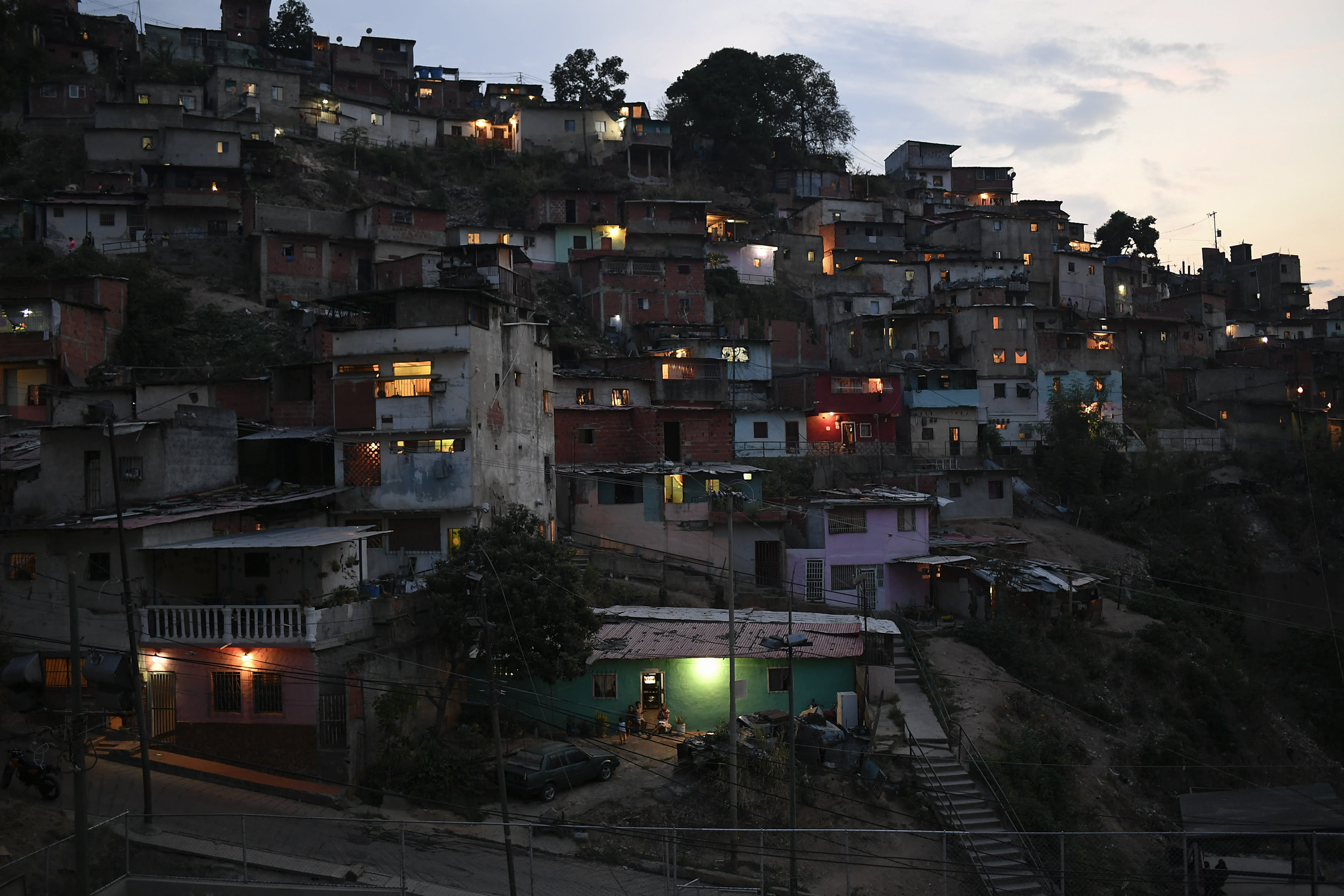 Homes cover a hill in the San Agustin neighborhood of Caracas, Venezuela, Sunday, May 17, 2020. President Nicolas Maduro is relaxing quarantine measures over the weekend by allowing children and older adults out of their homes for a few hours each day. (AP Photo/Matias Delacroix)