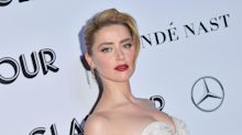 Amber Heard says she received death threats after Johnny Depp abuse allegations
