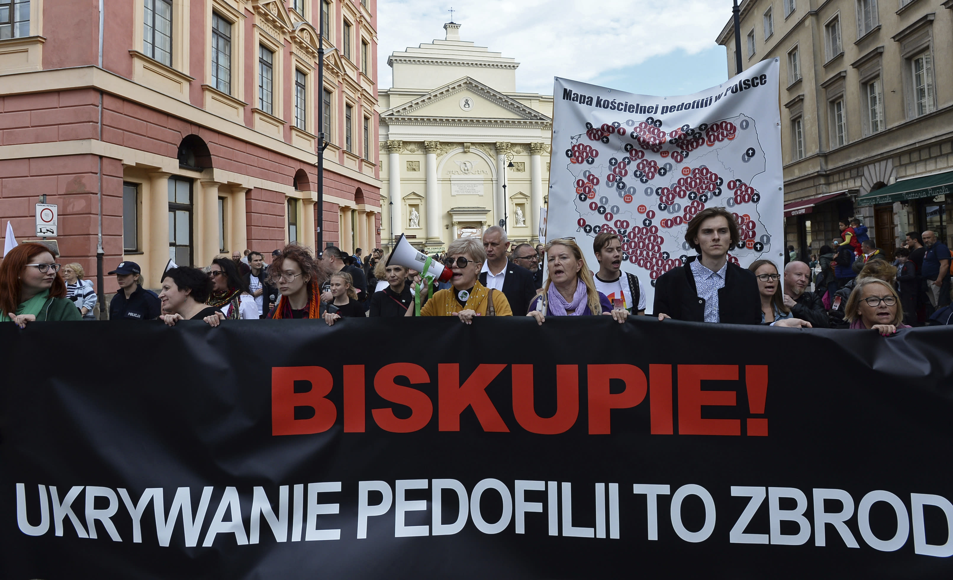 """Protesters carry a map of Poland with 255 documented cases of sexual abuse of minors by the country's Catholic priests, as they march in Warsaw, Poland, Sunday, Oct. 7, 2018, demanding the church to stop protecting pedophile priests. The writing on the banner reads: """"Bishop. Hiding Pedophilia is a Crime."""" (AP Photo/Alik Keplicz)"""