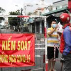 Vietnam's biggest cities tighten restrictions as COVID-19 cases surge