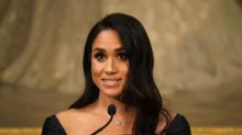Meghan Markle's feminist action comes full circle as she speaks at event presented by first company she campaigned against