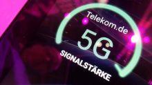 Deutsche Telekom cuts dividend as it faces U.S. merger uncertainty