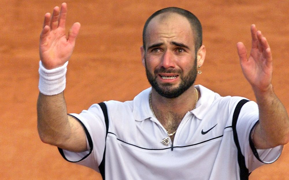 Andre Agassi reacts to winning the French Open in 1999 - AFP