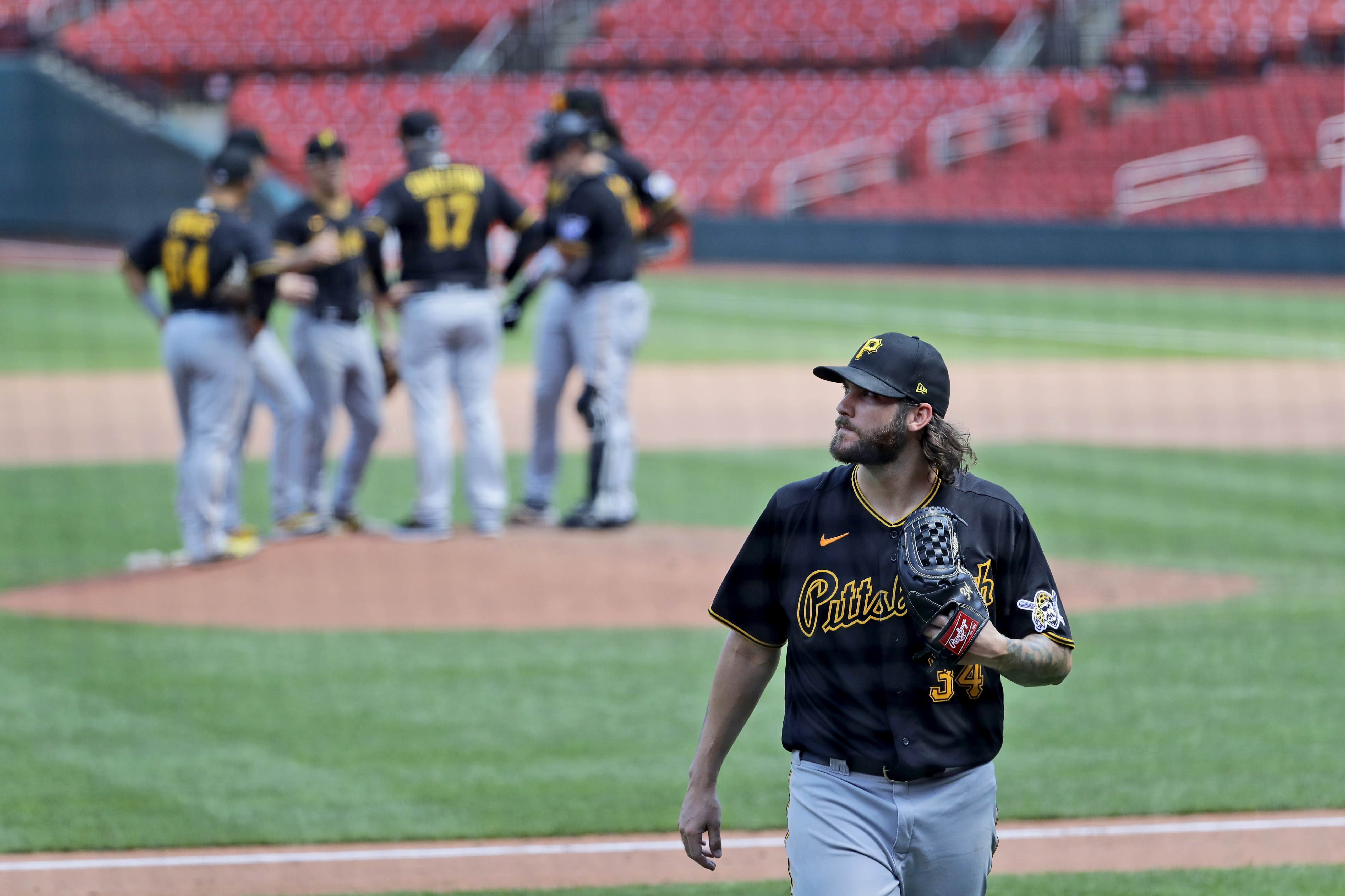 Pittsburgh Pirates starting pitcher Trevor Williams walks off the field after being removed during the fourth inning of a baseball game against the St. Louis Cardinals Saturday, July 25, 2020, in St. Louis. (AP Photo/Jeff Roberson)