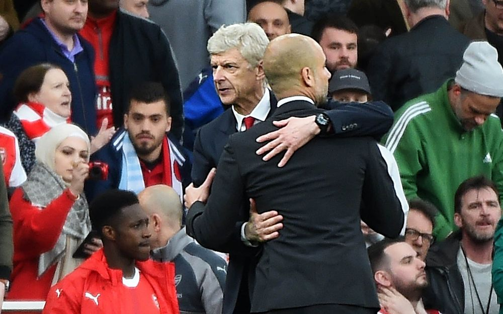 Arsene Wenger and Pep Guardiola embrace - EPA