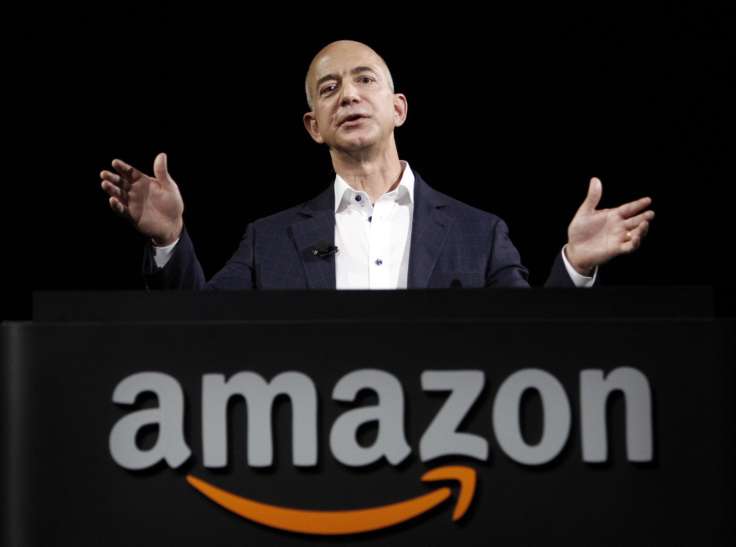 FILE - In this Sept. 6, 2012 file photo, Amazon founder and CEO Jeff Bezos speaks in Santa Monica, Calif. Bezos plans to buy The Washington Post for $250 million. (AP Photo/Reed Saxon, File)