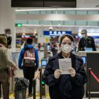 Beijing orders quarantine for foreign arrivals from virus-hit areas
