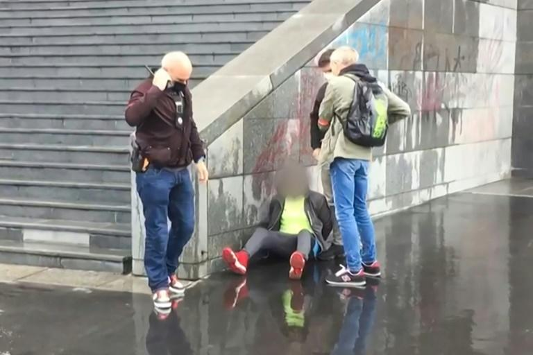 This image taken from a video obtained by AFP shows French police detaining an alleged suspect