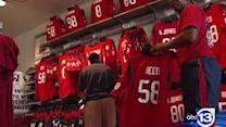 Texans fans buying up Battle Red gear