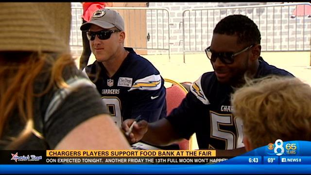 Charger players support food bank at the fair