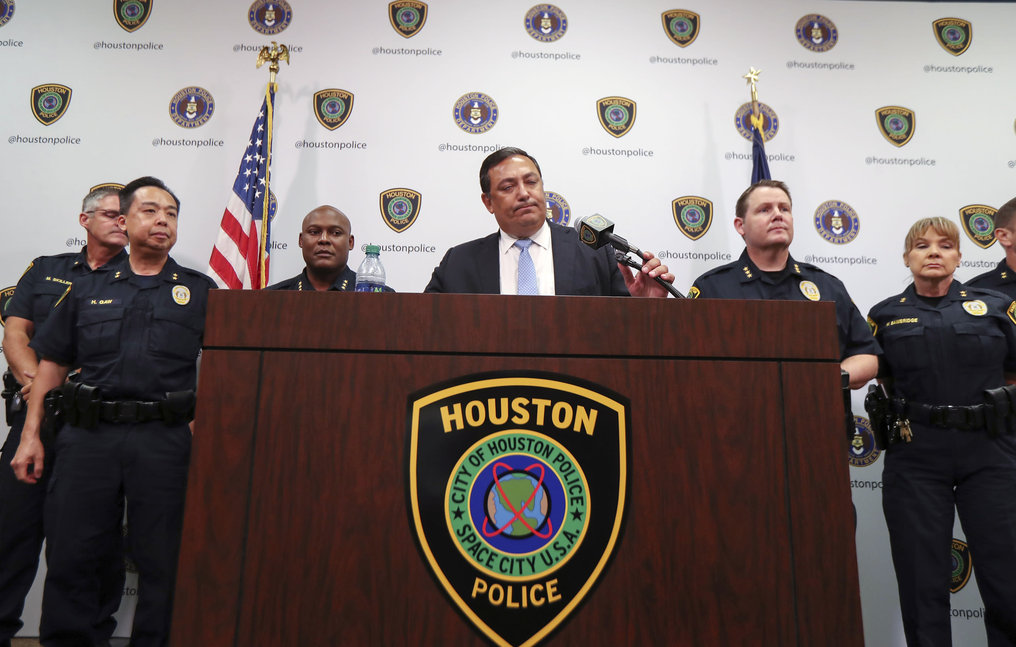 Houston Police Chief Art Acevedo address charges against two police officers in the fatal drug raid, Friday, Aug. 23, 2019, in Houston. A former Houston police officer has been charged with murder in connection with the deadly January drug raid of a home that killed a couple who lived there and injured five officers, prosecutors announced Friday. (Steve Gonzales/Houston Chronicle via AP)