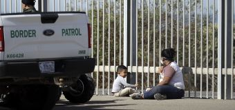 Advance guard of caravan reaches U.S. border and waits