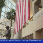 Protesters Gather In OC In Push To Rename John Wayne Airport