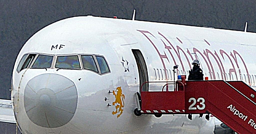 This picture taken on February 17, 2014 at Geneva airport in Switzerland shows the rope (L) used by the co-pilot of an Ethiopian Airlines flight to scale out of the cockpit window after he hijacked the plane, which was en route to Rome