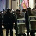 Protesters against COVID-19 restrictions clash with police in Spanish cities