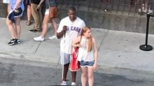 Woman helping blind Cubs fan hail cab will warm your heart