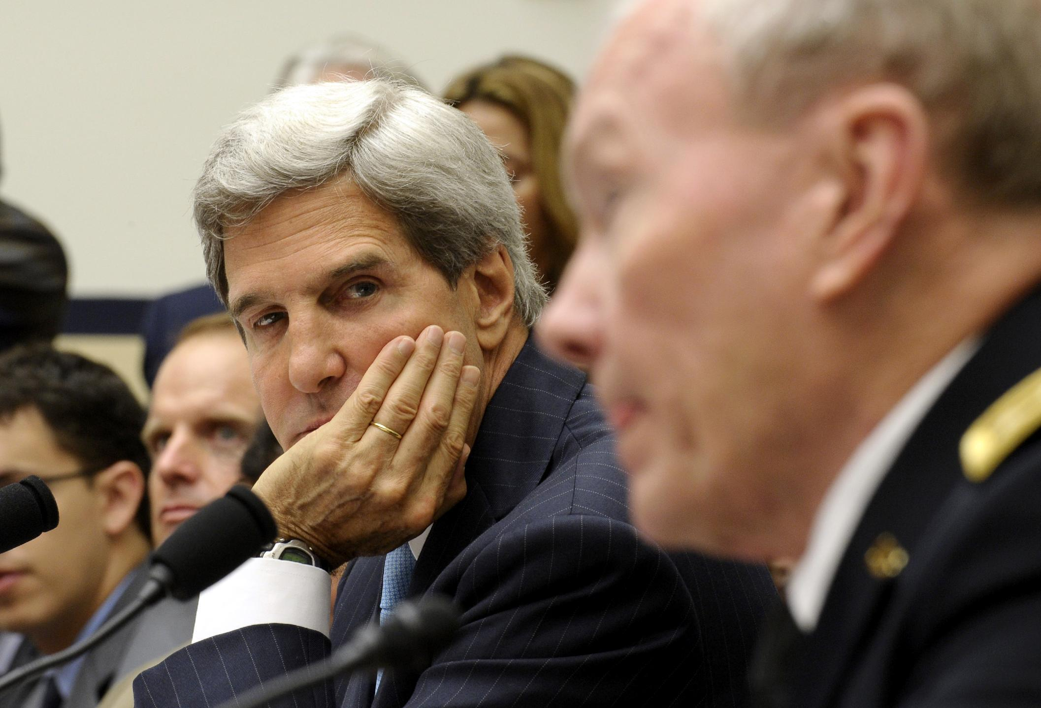 Secretary of State John Kerry listens at left as Joint Chiefs Chairman Gen. Martin Dempsey, right, speaks during a House Armed Services Committee hearing on Syria, Tuesday, Sept. 10, 2013, on Capitol Hill in Washington. (AP Photo/Susan Walsh)