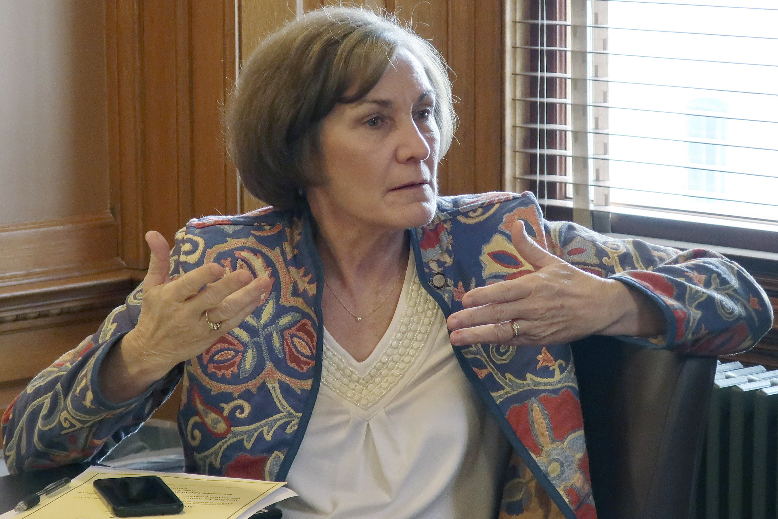 FILE - In this Feb. 13, 2019, file photo, state Sen. Barbara Bollier, D-Mission Hills, speaks during a meeting of Democratic senators at the Statehouse in Topeka, Kan. Rep. Roger Marshall and Bollier meet in their first debate of their race to replace retiring Sen. Pat Roberts. (AP Photo/John Hanna, File)