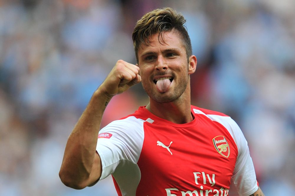 Arsenal's French striker Olivier Giroud celebrates scoring their third goal during the FA Community Shield football match between Arsenal Manchester City at Wembley Stadium in north London on August 10, 2014