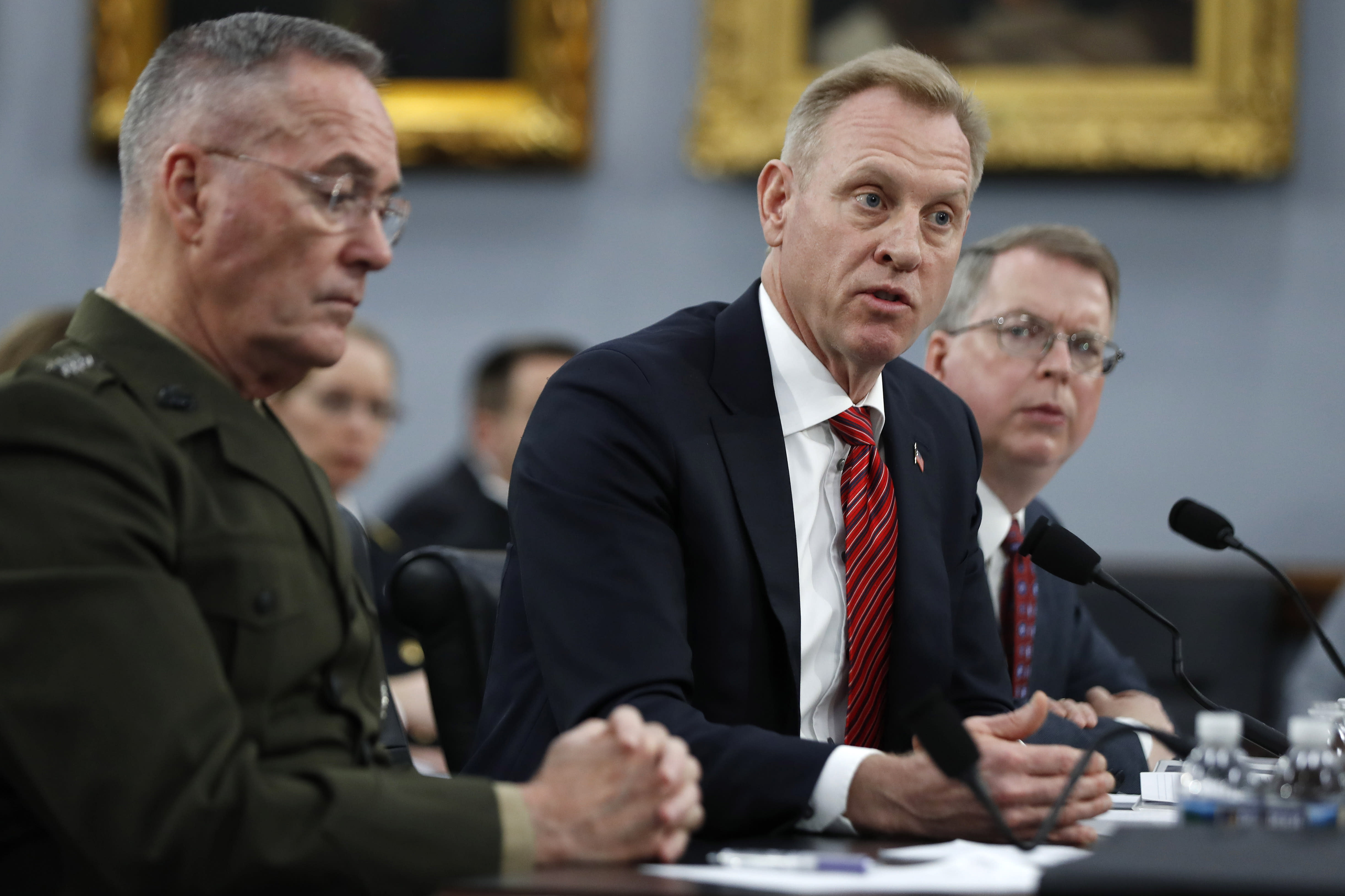 Joint Chiefs of Staff Chairman Gen. Joseph Dunford, left, Acting Defense Secretary Patrick Shanahan, and Acting Deputy Secretary of Defense David Norquist, testify, Wednesday May 1, 2019, to a House Appropriations subcommittee on budget hearing on Capitol Hill in Washington. (AP Photo/Jacquelyn Martin)