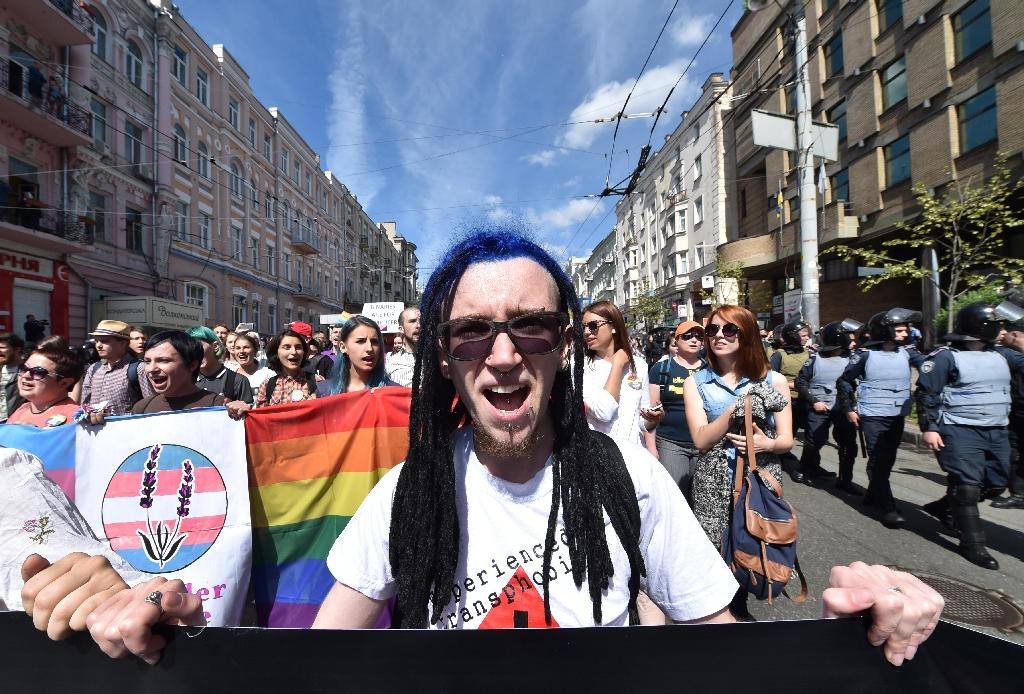 The Gay Pride parade on June 12, 2016 in Kiev brought out more than 700 activists through the streets of Kiev on June 12, 2016 (AFP Photo/Sergei Supinsky)