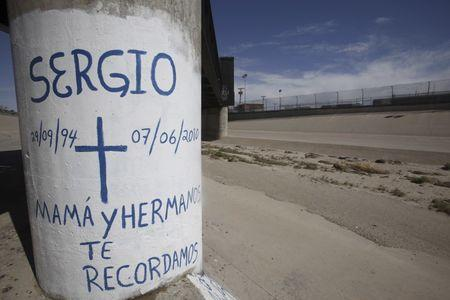 Graffiti is seen at the site where Sergio Adrian Hernandez was shot dead in 2010 under a railroad bridge connecting El Paso with Ciudad Juarez