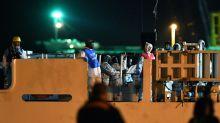 Italian coastguard ship carrying 522 migrants docks in Sicily