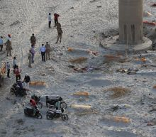 Hundreds of bodies found buried along Indian riverbanks