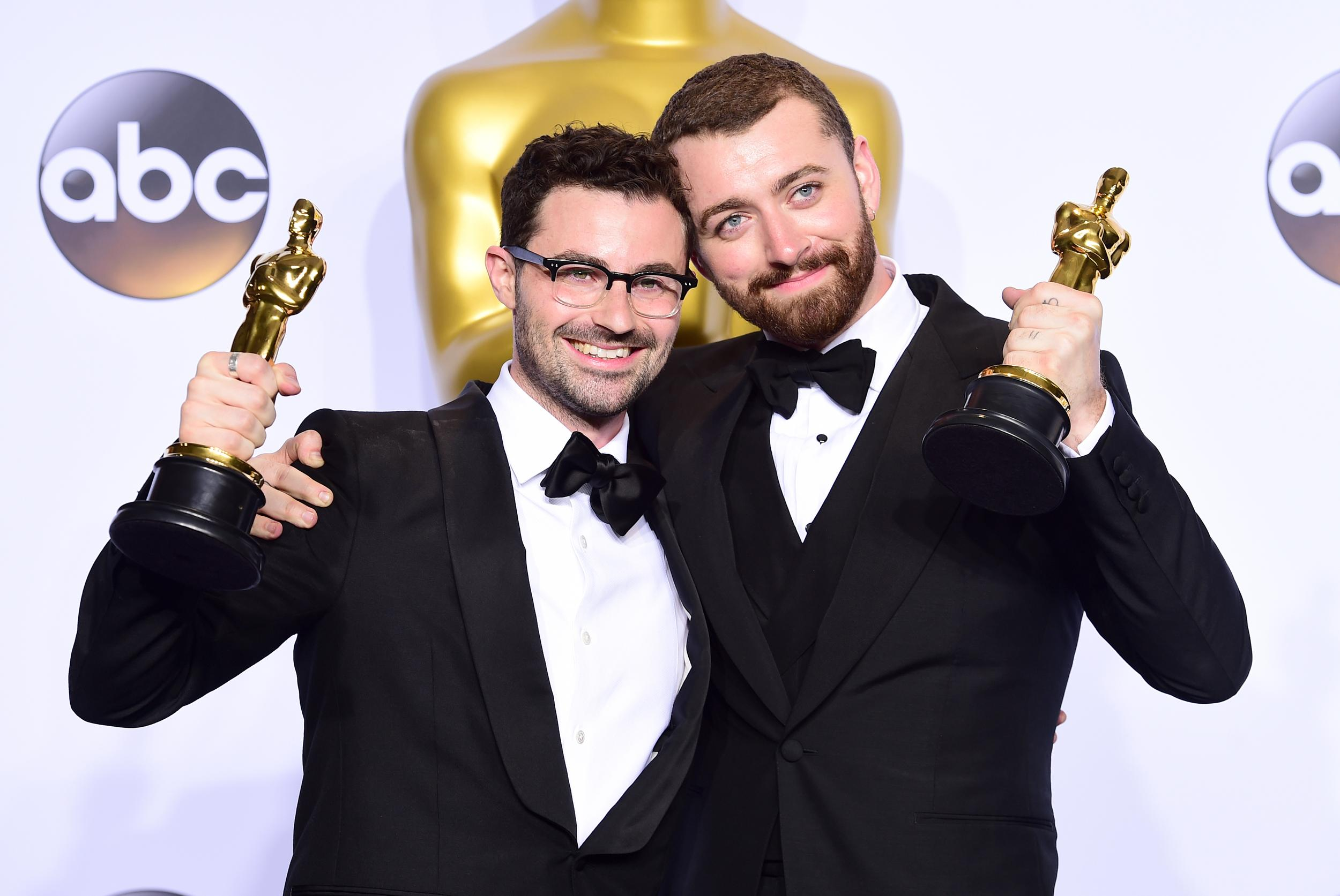 """File photo dated 28/02/16 of Sam Smith (right) and Jimmy Napes with the Academy Awards for Best Original Song following the 88th Academy Awards. Smith has said he is finally trying to """"embrace"""" his Oscar after years of hiding it away."""