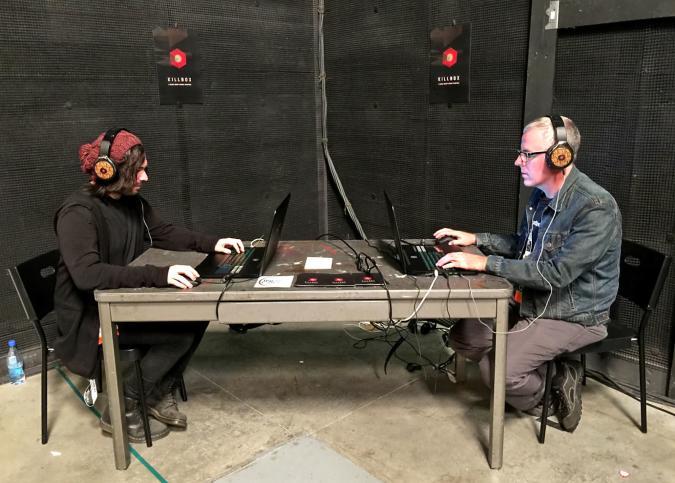 Albert Elwin and Joseph DeLappe play 'Killbox' at IndieCade 2016.