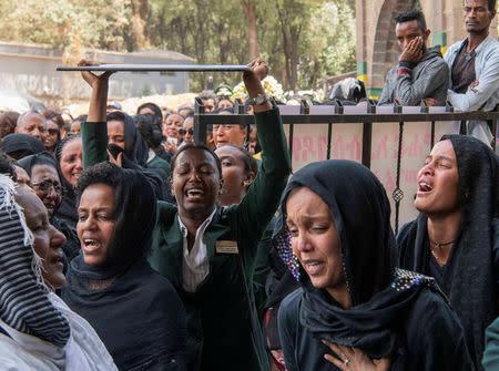 At Ethiopia flight memorial, white roses mark passing of lives