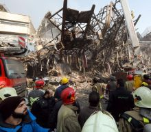 Many firefighters dead, trapped in Tehran high-rise collapse