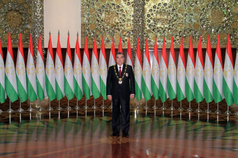 FILE PHOTO: Tajikistan's President Rakhmon poses for photographers during his inauguration ceremony in Dushanbe
