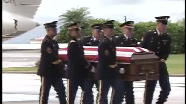 One soldier laid to rest as another returns home