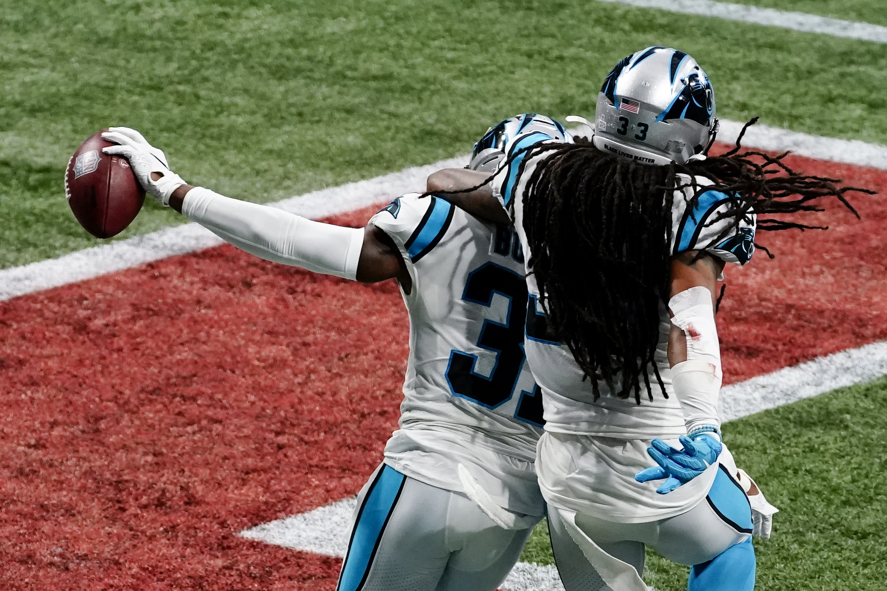 Carolina Panthers strong safety Juston Burris (31) celebrates his interception with Carolina Panthers free safety Tre Boston (33) during the second half of an NFL football game against the Atlanta Falcons, Sunday, Oct. 11, 2020, in Atlanta. (AP Photo/Brynn Anderson)