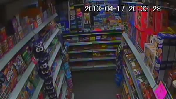 Shopkeeper sees off robber with bottle of Lucozade