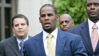 R. Kelly charged in sexual abuse case